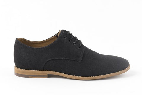 Simple black canvas oxford, lace up with 4 eyelets. Tan sole.