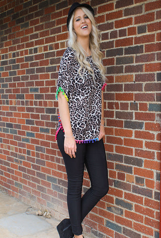 Carleigh's Cheetah Print Top with Multicolored Boho Pom Trim