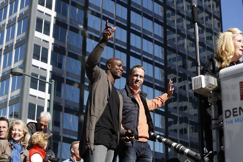 DeMarcus Ware rocked a roaming hood iv with a knomadik layered tee, next to Peyton Manning at the Denver Broncos Super Bowl parade
