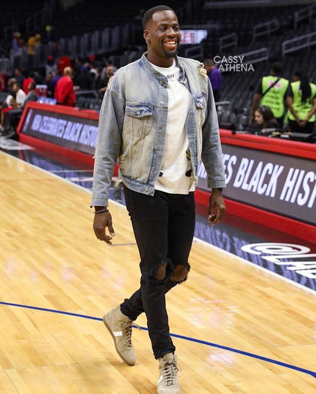 Draymond Green in an all-out daniel patrick outfit: blue desert oversized denim jacket, black classic ripped skinny jean ii, and sand high top roamers
