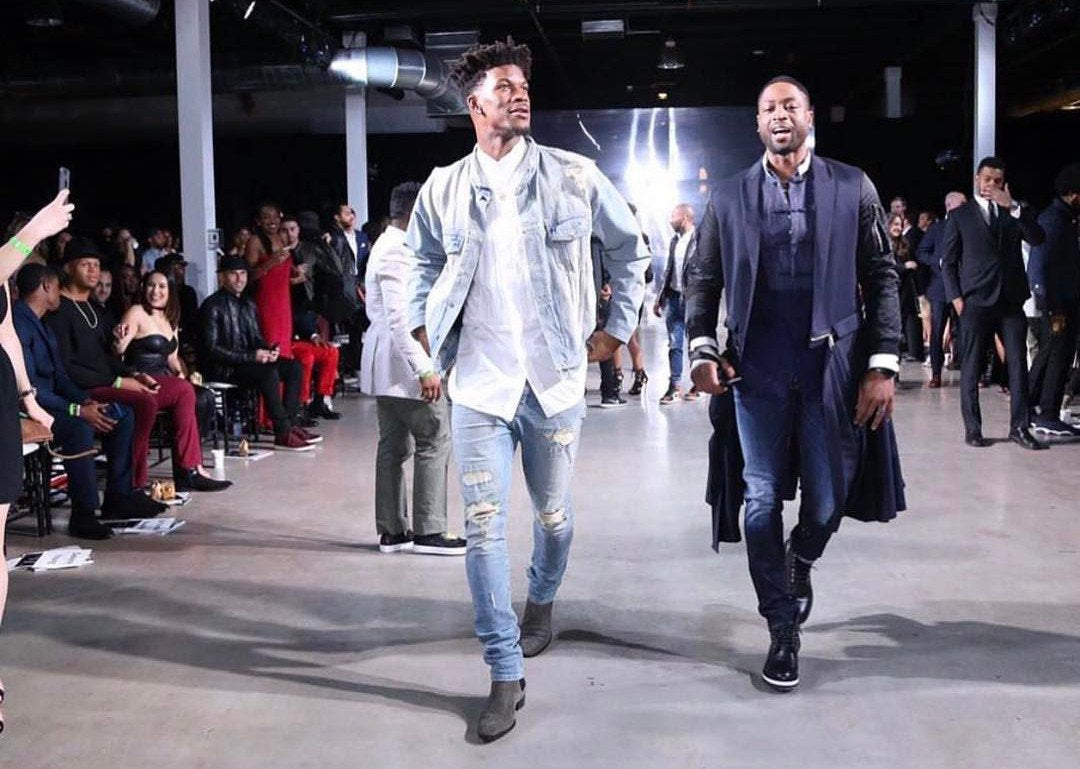 Jimmy Butler, wearing daniel patrick blue desert oversized denim jacket, with his Chicago Bulls teammate Dwyane Wade