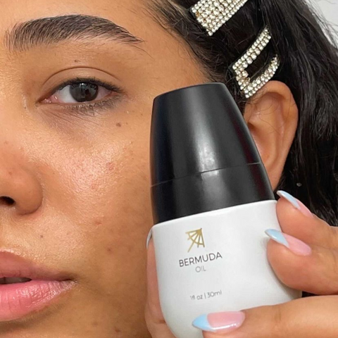 Female Using Bermuda Oil To Help Treat Dark Spots Naturally