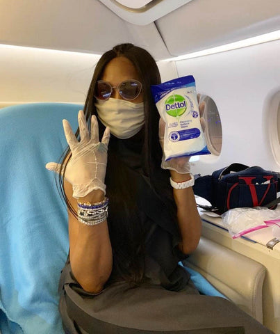Naomi Campbell cleans plane tray table