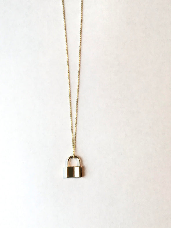 Medium gold lock necklace on a fine chain