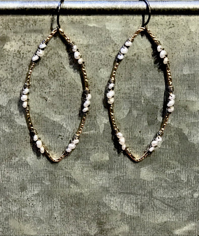 Long gold and pearl earrings
