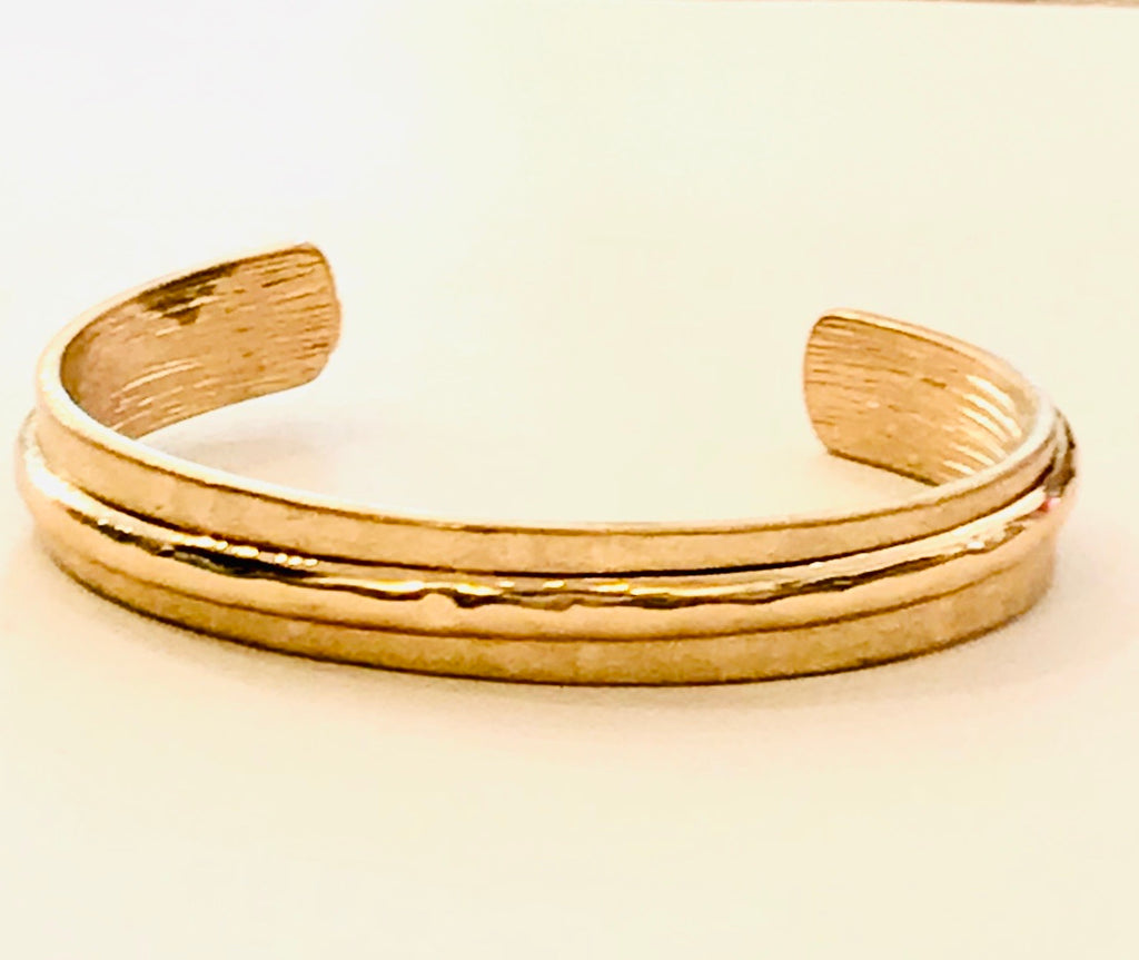 Cuff bracelet with hammered detail.