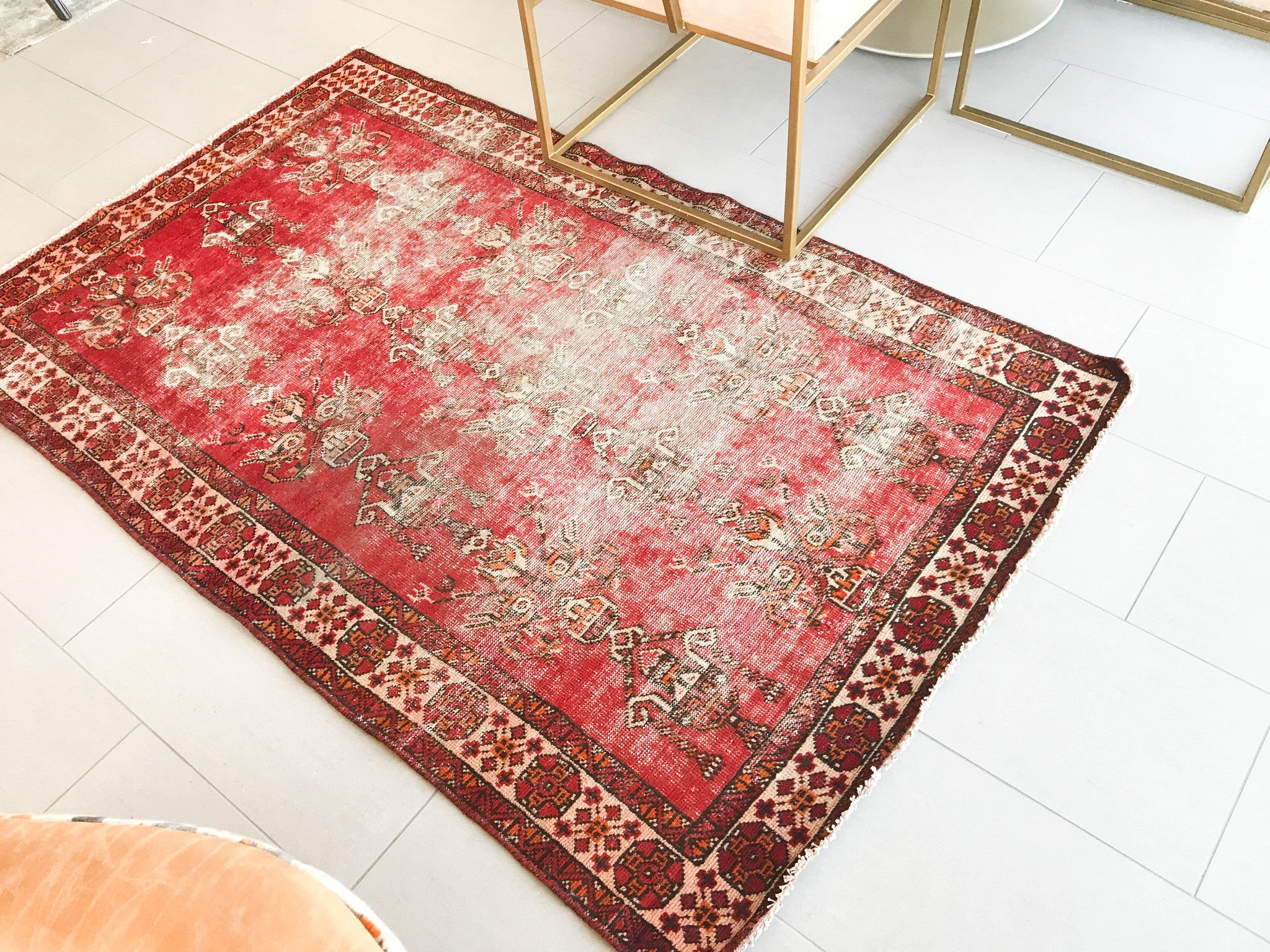 vintage distressed rug as bathroom rug