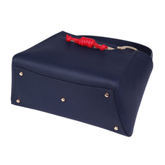 A navy convertible leather tote bag for work with a red and nude detachable clutch in front, base image.