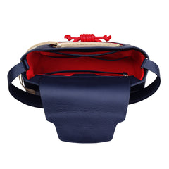 A navy convertible leather tote bag for work with a red and nude detachable clutch in front, red interior image.