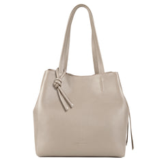 An expandable leather tote bag for women in nude that could be used as a travel bag, front image.