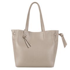 An expandable leather tote bag for women in nude shown as a travel bag, front image.