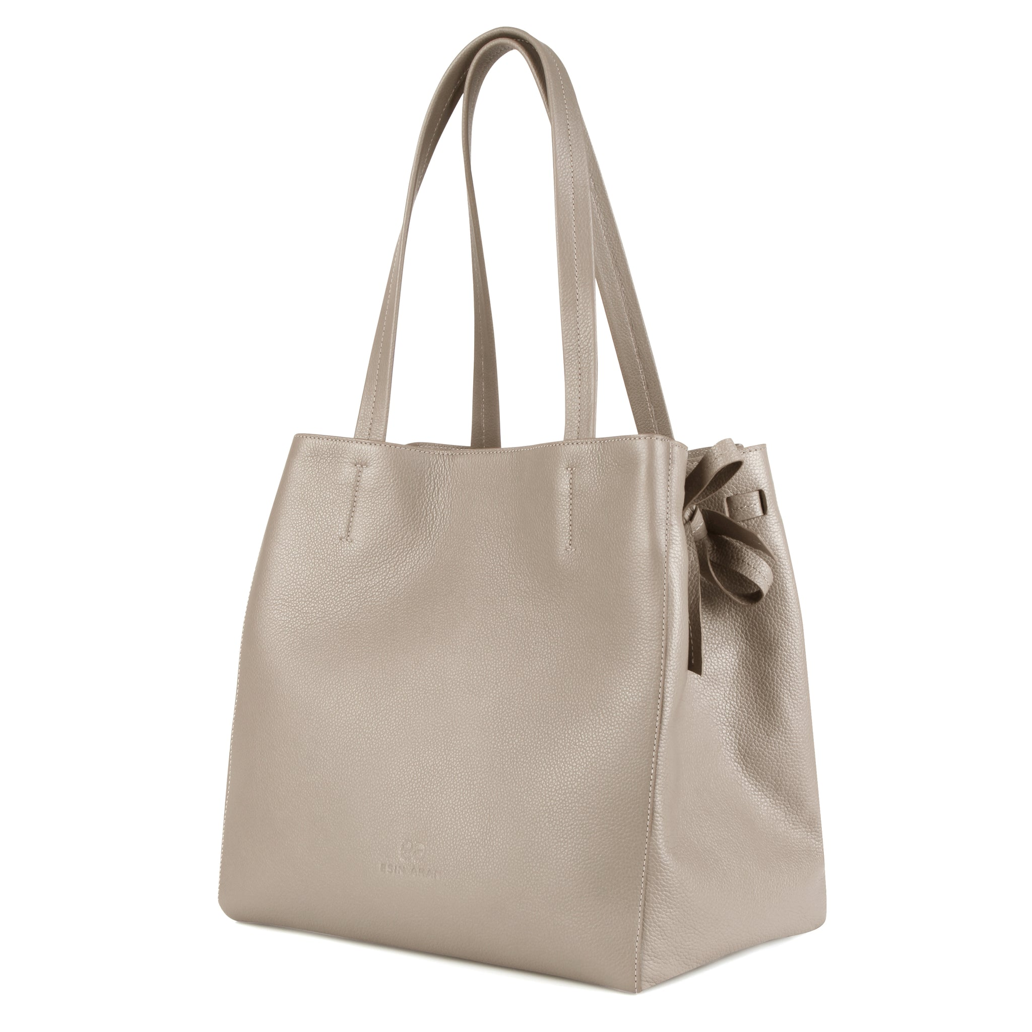 An expandable leather tote bag for women in nude that could be used as a travel bag, side image.