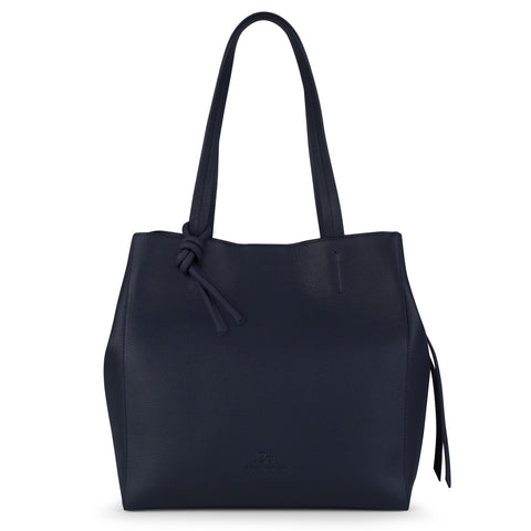 An expandable leather tote bag for women in navy that could be used as a travel bag, front image.