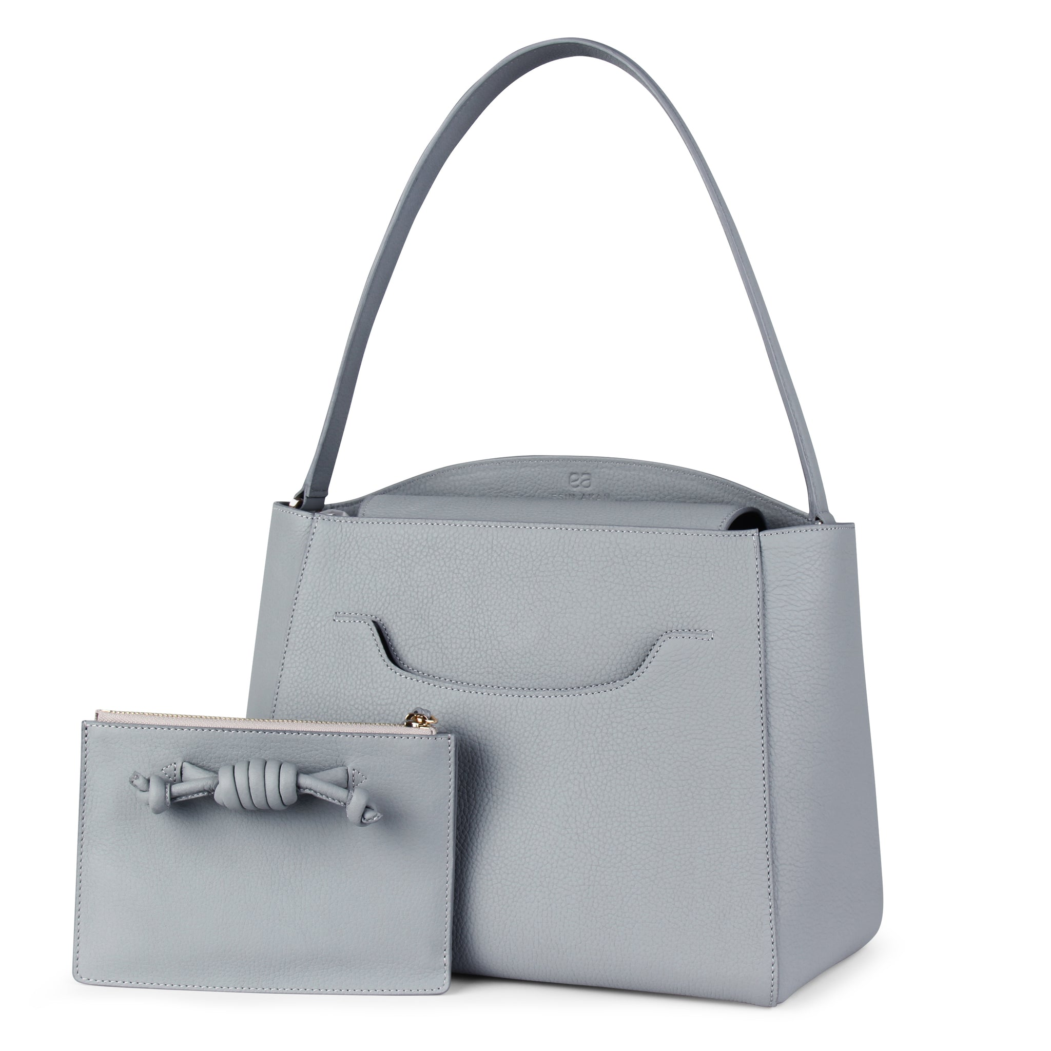 A light grey convertible leather tote bag for work with a detachable clutch in front, front image.