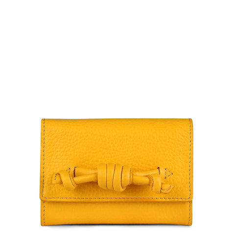 A leather yellow coin purse with a knot detail, front image.