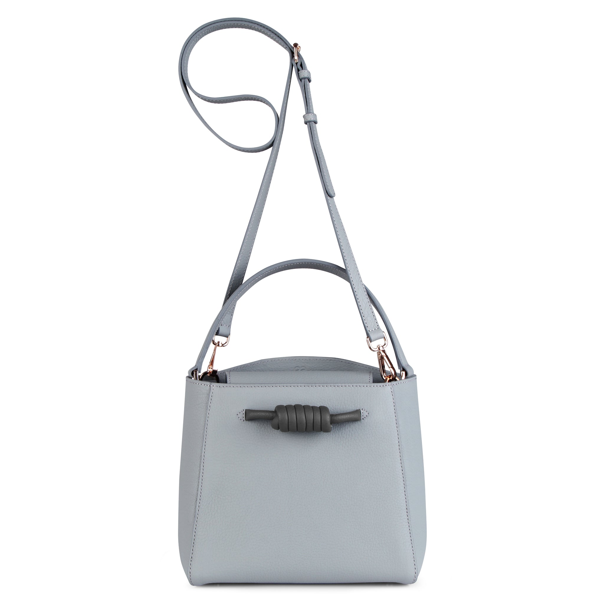 A medium size grey convertible leather top handle tote bag with a knot detail in front that could be used as a handheld mini tote bag, front image.