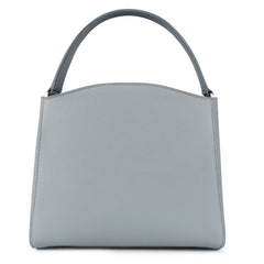 A medium size grey convertible leather top handle tote bag with a knot detail in front that could be used as a handheld mini tote bag, back image.