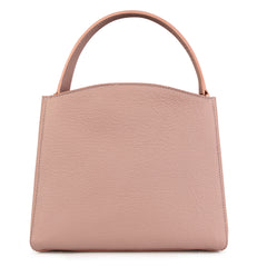 A medium size pink convertible leather top handle tote bag with a knot detail in front that could be used as a handheld mini tote bag, back image.