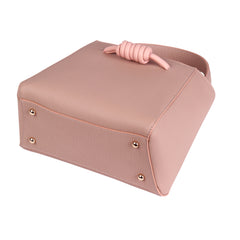 A medium size pink convertible leather top handle tote bag with a knot detail in front that could be used as a handheld mini tote bag, base image.