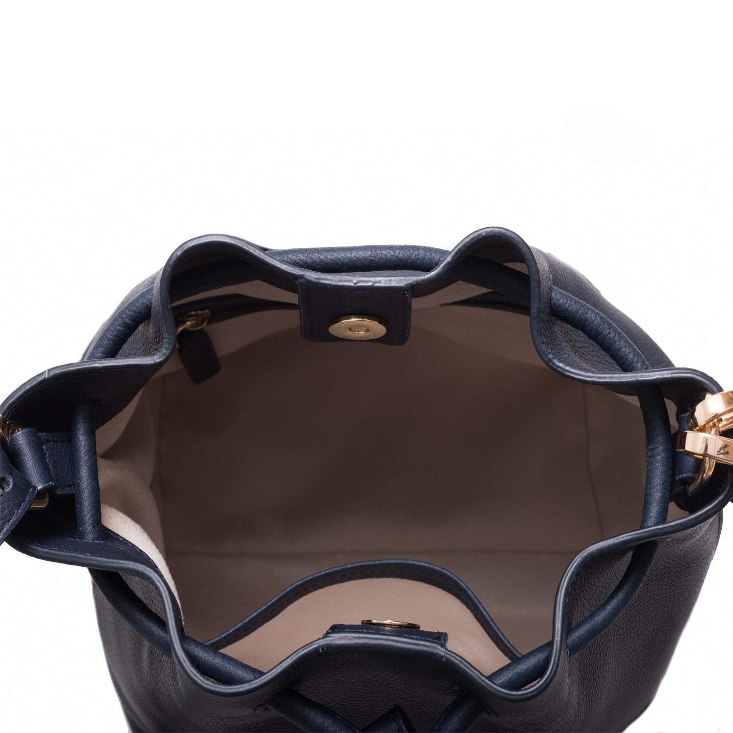 A convertible medium leather bucket crossbody bag in sparkly navy, interior image.