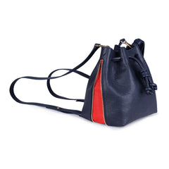 A convertible medium leather bucket crossbody bag in navy and red that could be used as a backpack, side image.
