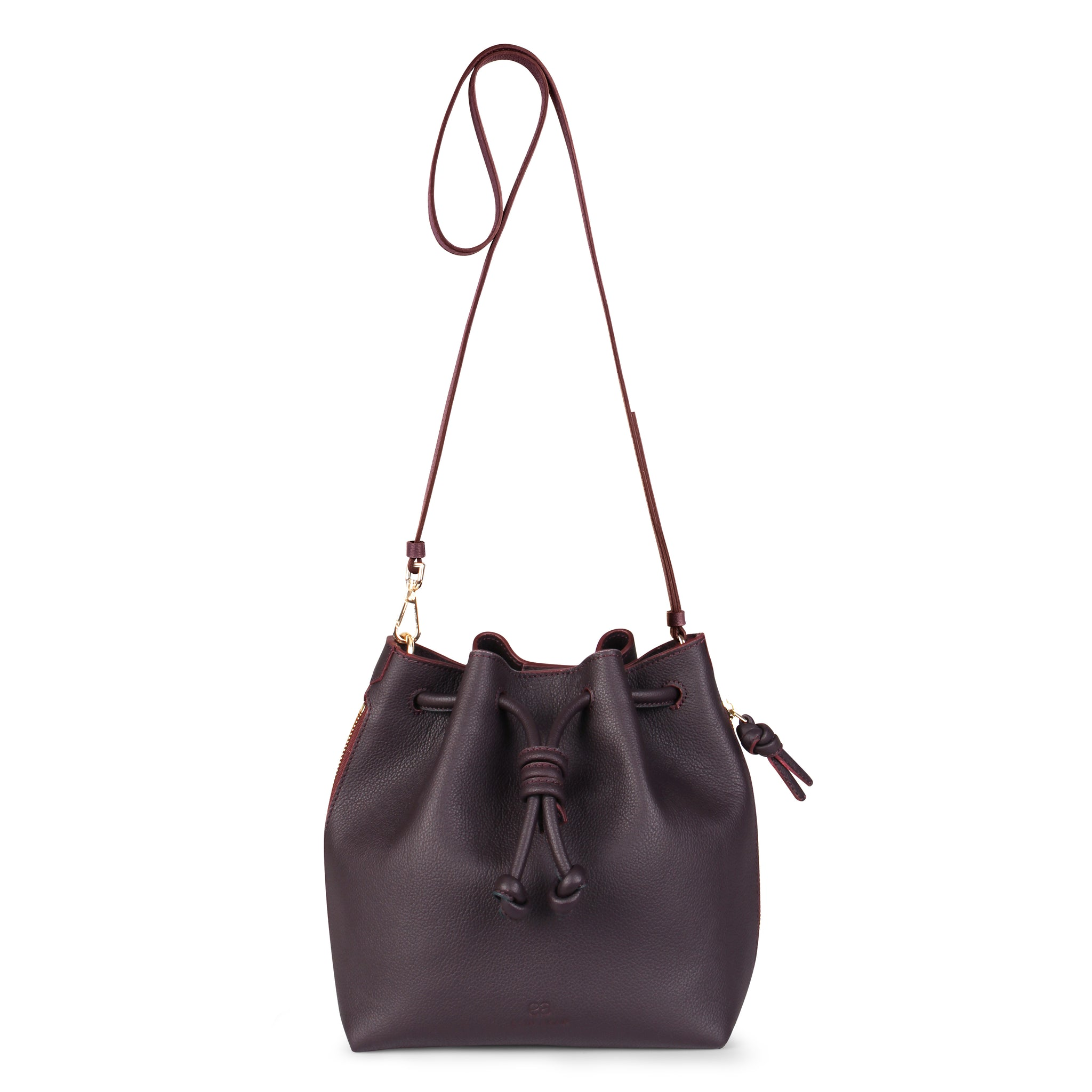 A convertible medium leather bucket crossbody bag in burgundy and pink that could be used as a backpack, front image.