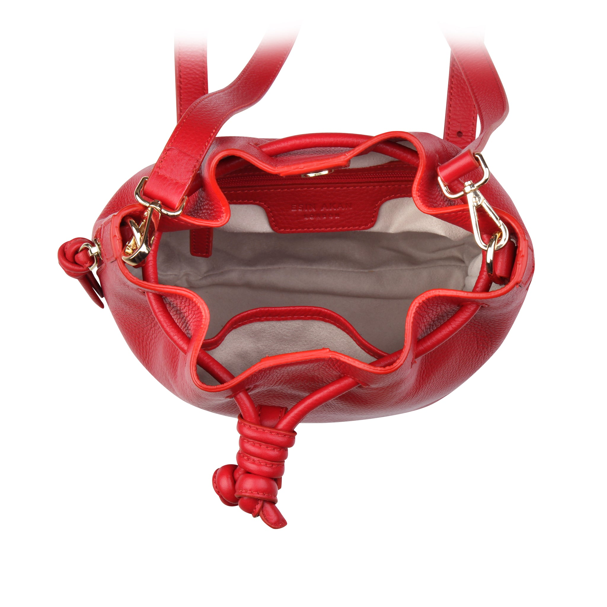 A convertible medium leather bucket crossbody bag in red, interior image.