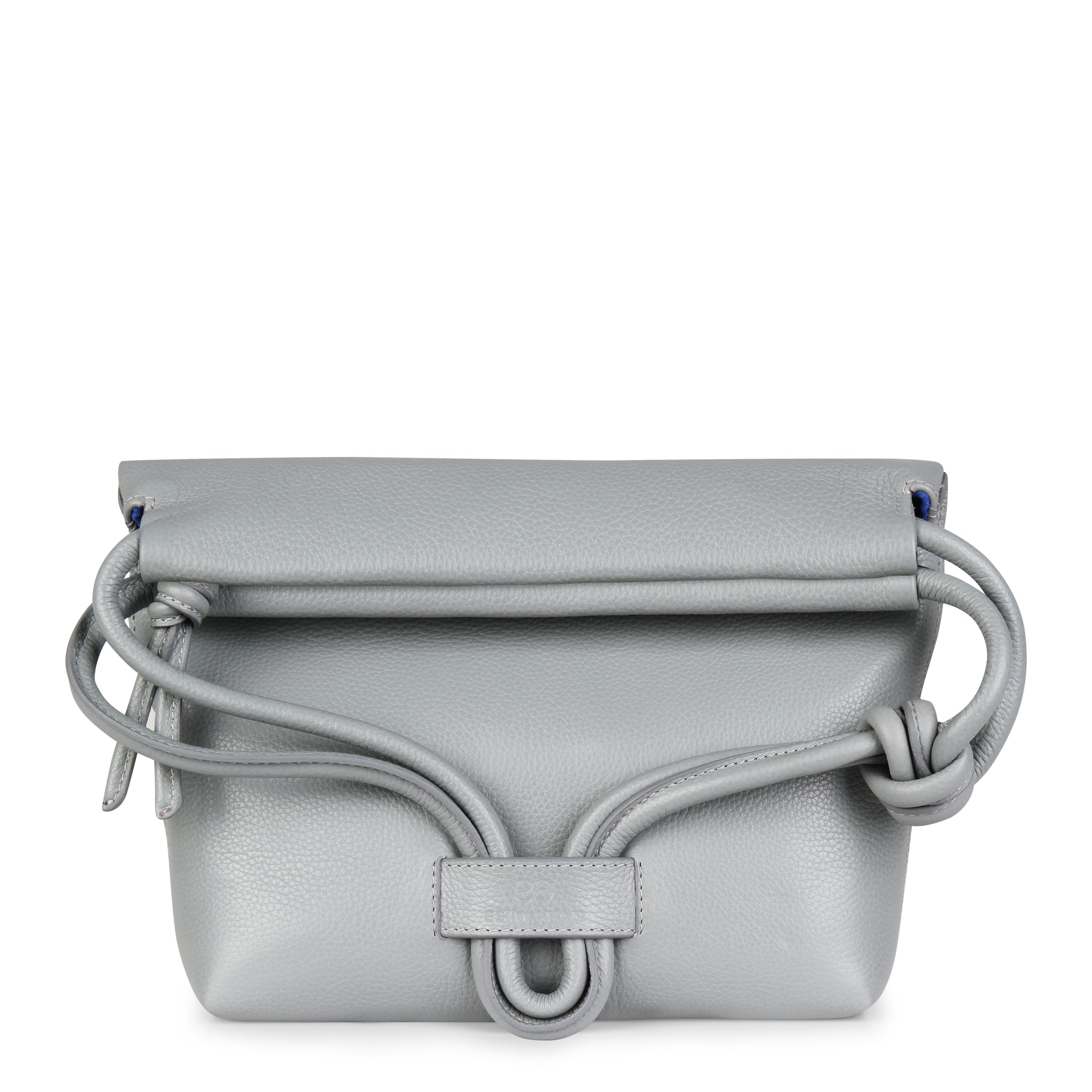 A light grey convertible leather small shoulder bag with a knot detail on the strap shown as a clutch with its roll down feature.