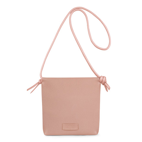 A nude pink convertible leather small shoulder bag with a knot detail on the strap that could be used as a clutch with its roll down feature, front image.