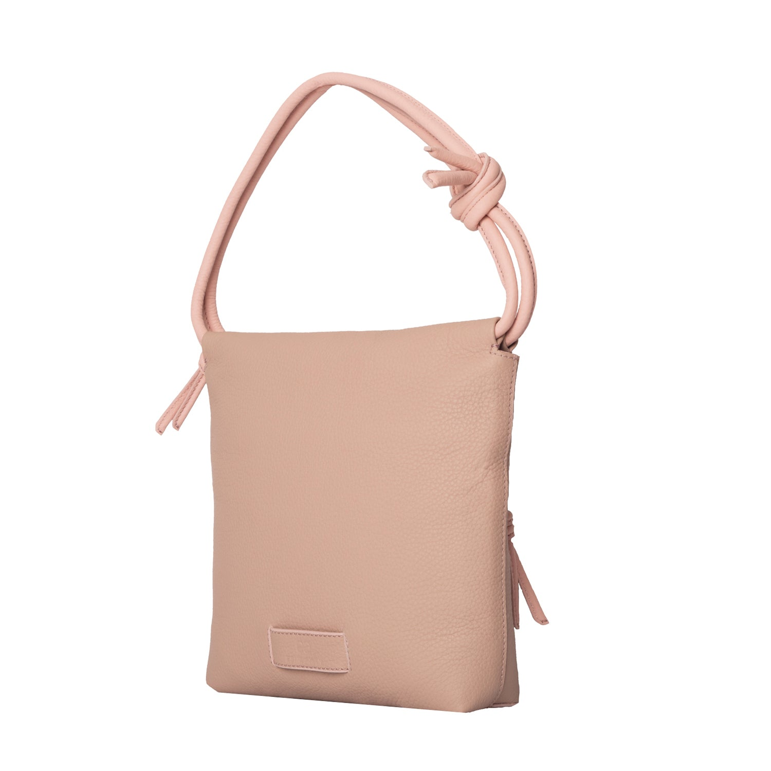 A nude pink convertible leather small shoulder bag with a knot detail on the strap that could be used as a clutch with its roll down feature, side image.