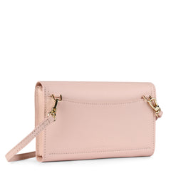 A convertible leather pink phone wallet with a knot detail in front that could be used as a crossbody bag, back image.