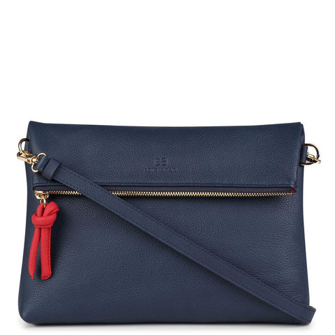 A navy and red convertible leather crossbody bag for women with a zipper that could be used as a clutch in the evening, front image.