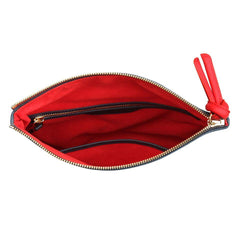 A navy and red convertible leather crossbody bag for women, red interior image.