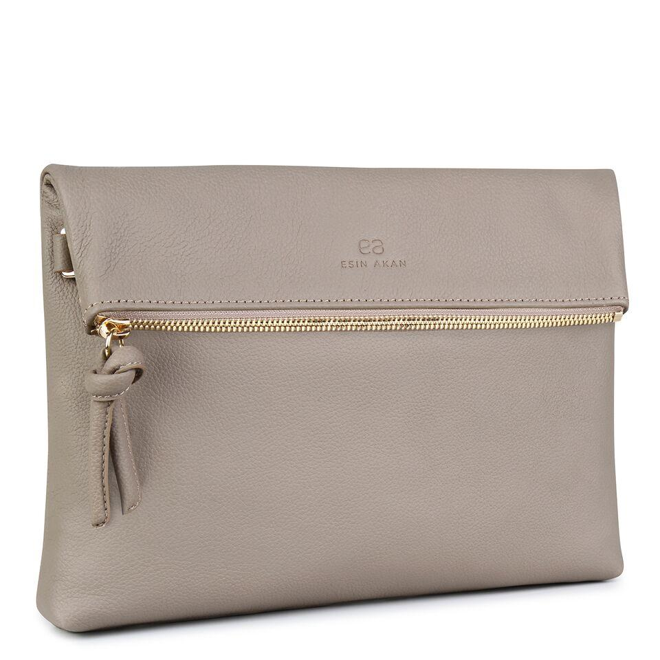 A nude convertible leather crossbody bag for women with a zipper that could be used as a clutch in the evening, side image.