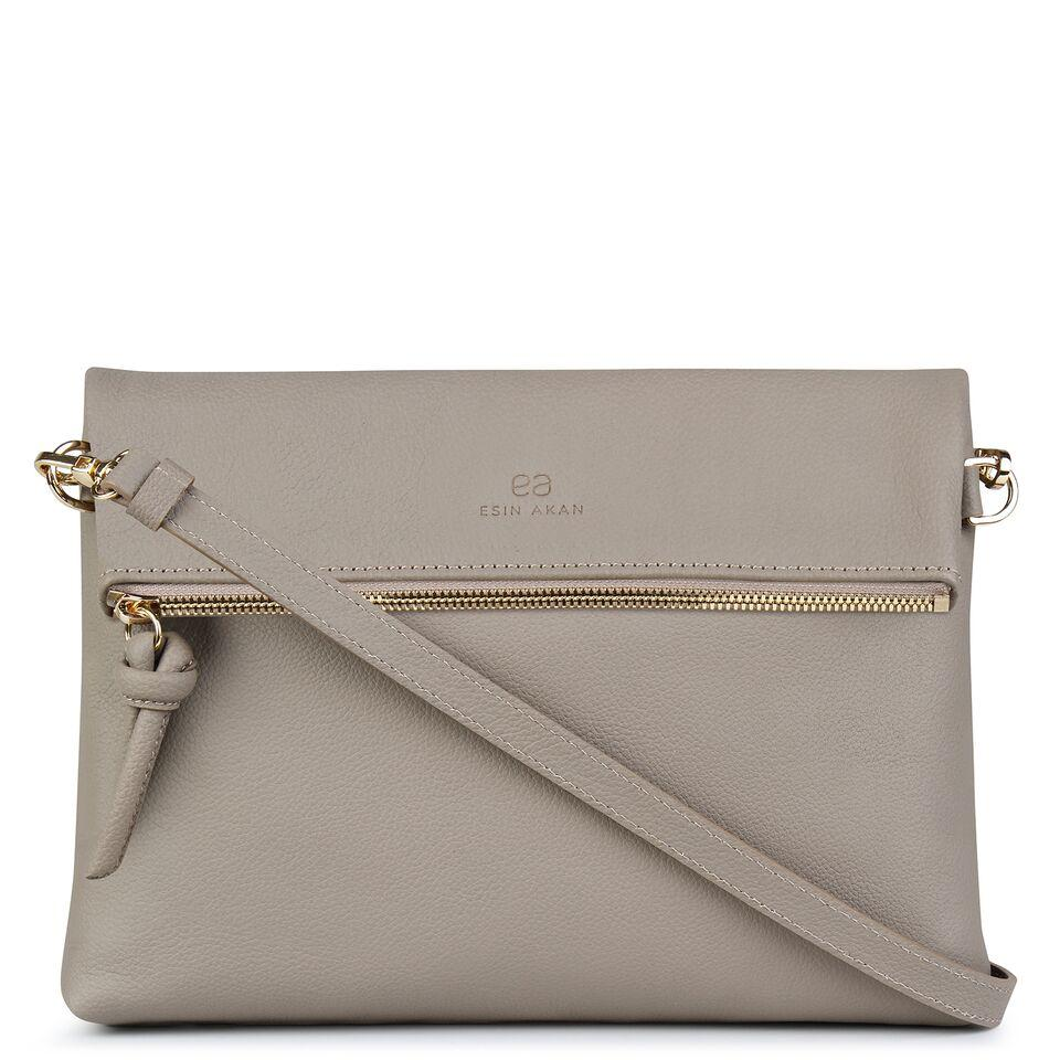 A nude convertible leather crossbody bag for women with a zipper that could be used as a clutch in the evening, front image.