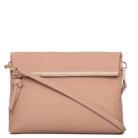 A nude pink convertible leather crossbody bag for women with a zipper that could be used as a clutch in the evening, front image.