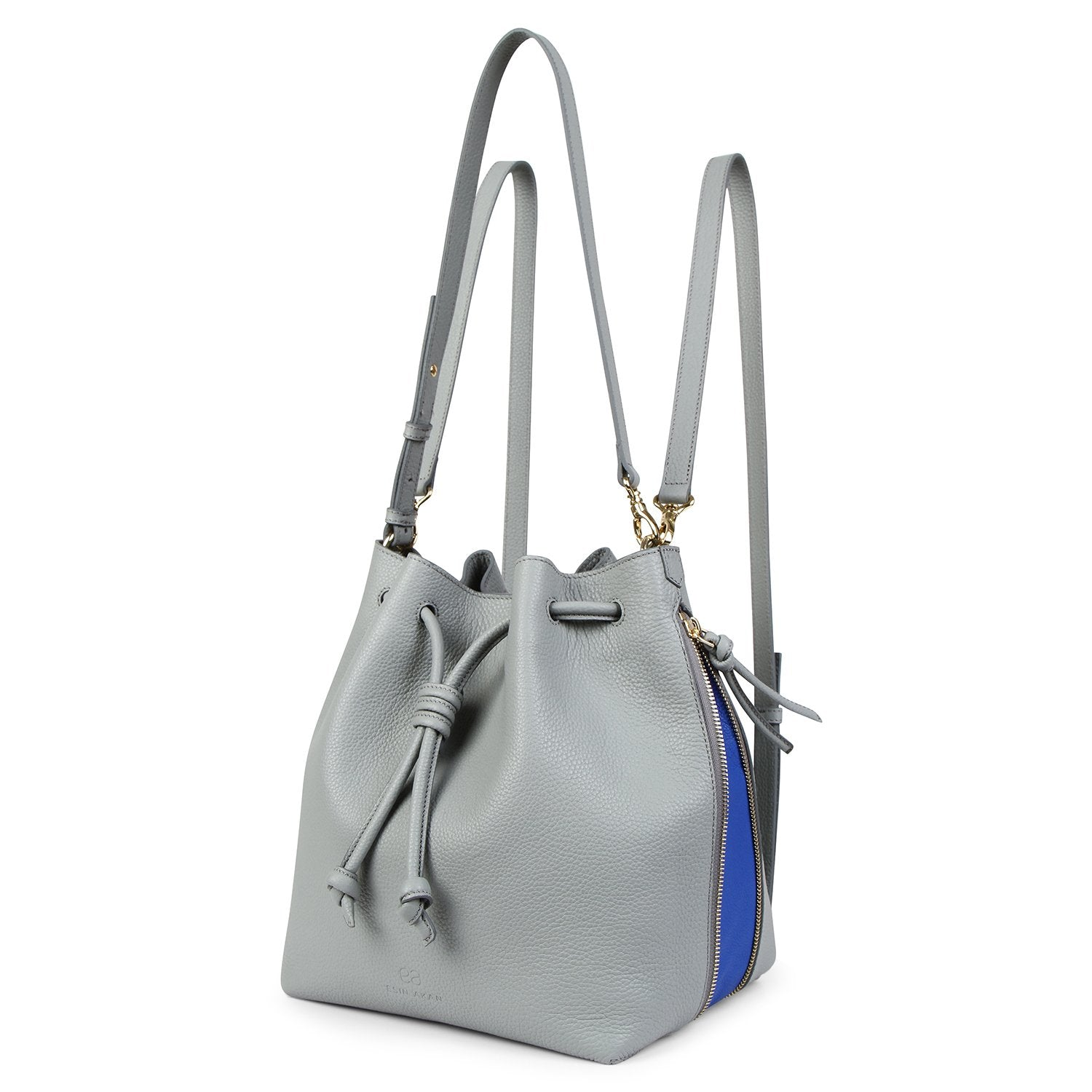 A convertible laptop size womens leather backpack in light grey that could be used as a crossbody as well as a bucket bag, front image.