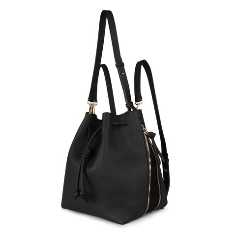 A convertible laptop size womens black leather backpack that could be used as a crossbody as well as a bucket bag, front image.