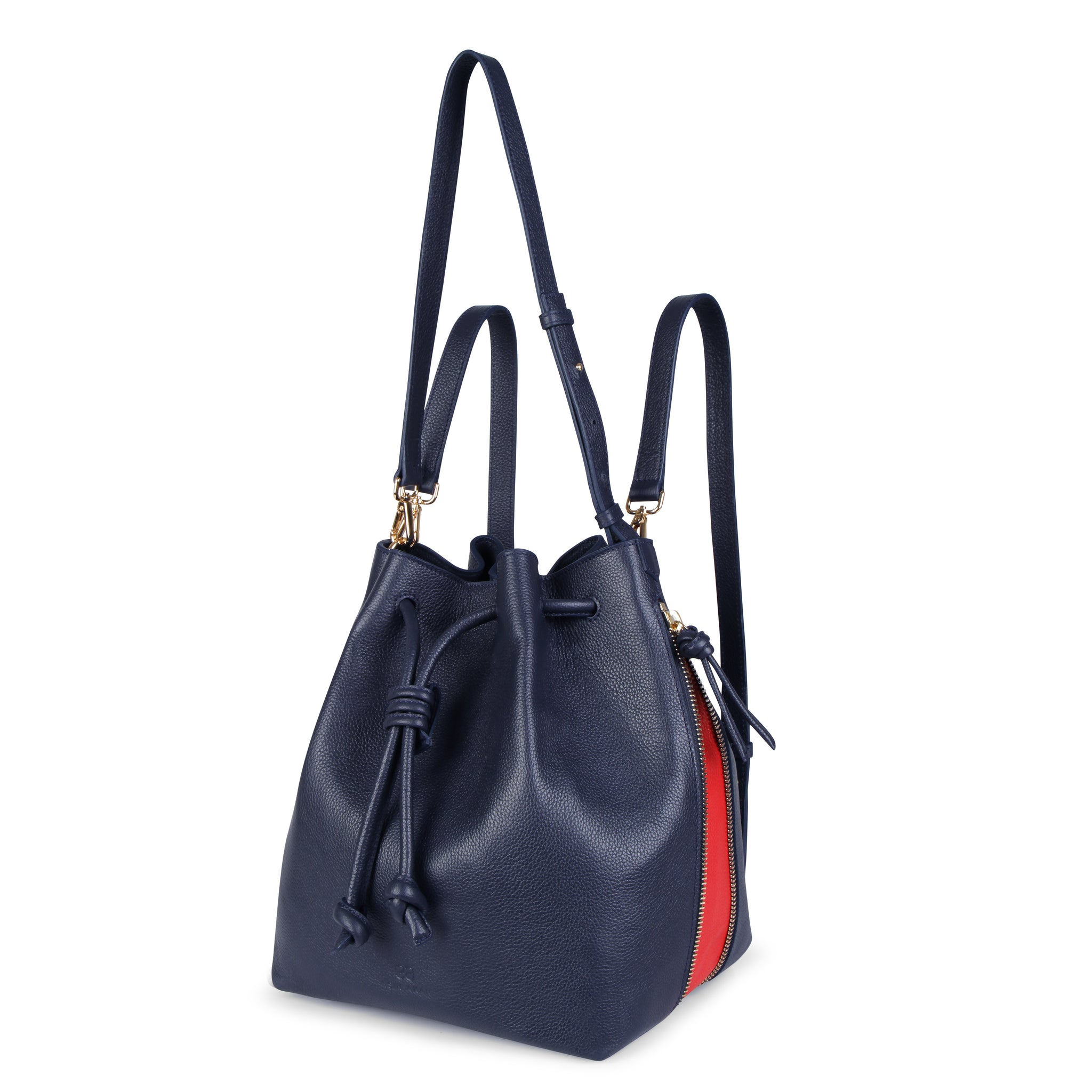 A convertible laptop size womens leather backpack in navy that could be used as a crossbody as well as a bucket bag, front image.