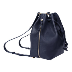 A convertible laptop size womens leather backpack in navy that could be used as a crossbody as well as a bucket bag, side image.