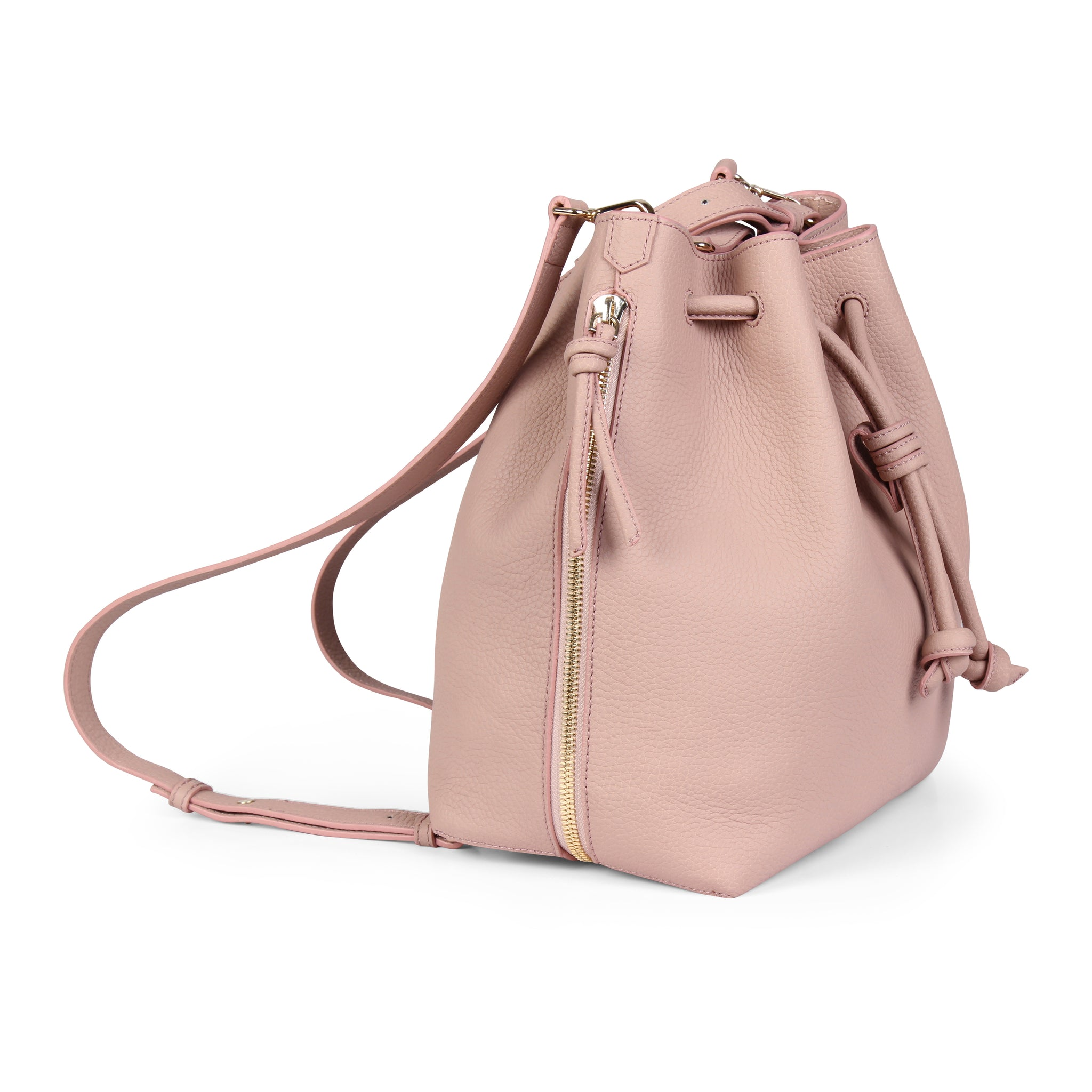 A convertible laptop size womens leather backpack in pink that could be used as a crossbody as well as a bucket bag, zippers closed, side image.