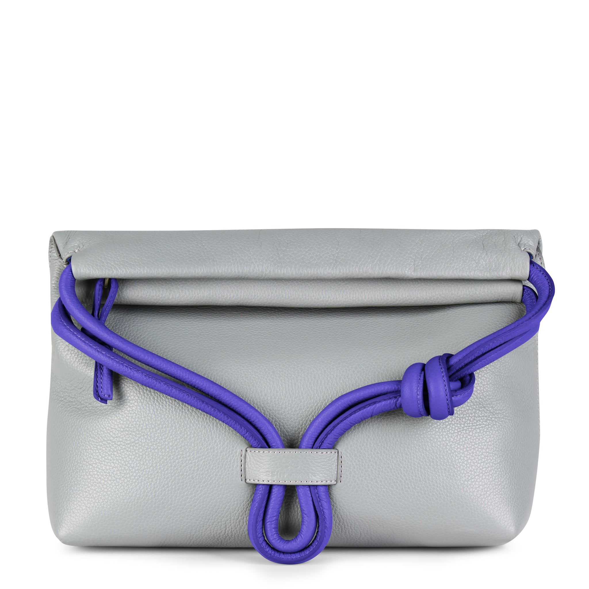 A convertible leather blue and grey shoulder bag for women with a knot detail on the strap shown as a clutch bag, front image.