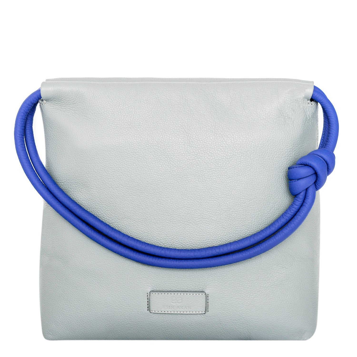 A convertible leather blue and grey shoulder bag for women with a knot detail on the strap that could be used as a clutch bag with its roll down feature, front image.