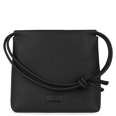 A convertible leather black shoulder bag with a knot detail on the strap that could be used as a clutch bag with its roll down feature, front image.