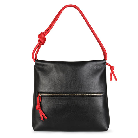 A convertible leather red and black shoulder bag for women with a knot detail on the strap that could be used as a clutch bag with its roll down feature, back image.