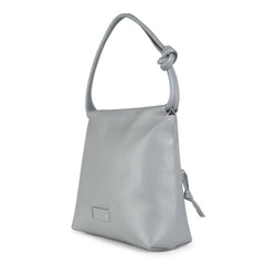 A convertible leather light grey shoulder bag for women with a knot detail on the strap that could be used as a clutch bag with its roll down feature, side image.