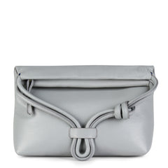 A convertible leather light grey shoulder bag for women with a knot detail on the strap shown as a clutch bag, front image.