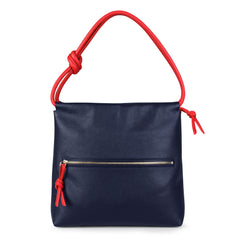 A convertible leather red and navy shoulder bag for women with a knot detail on the strap that could be used as a clutch bag with its roll down feature, back image.
