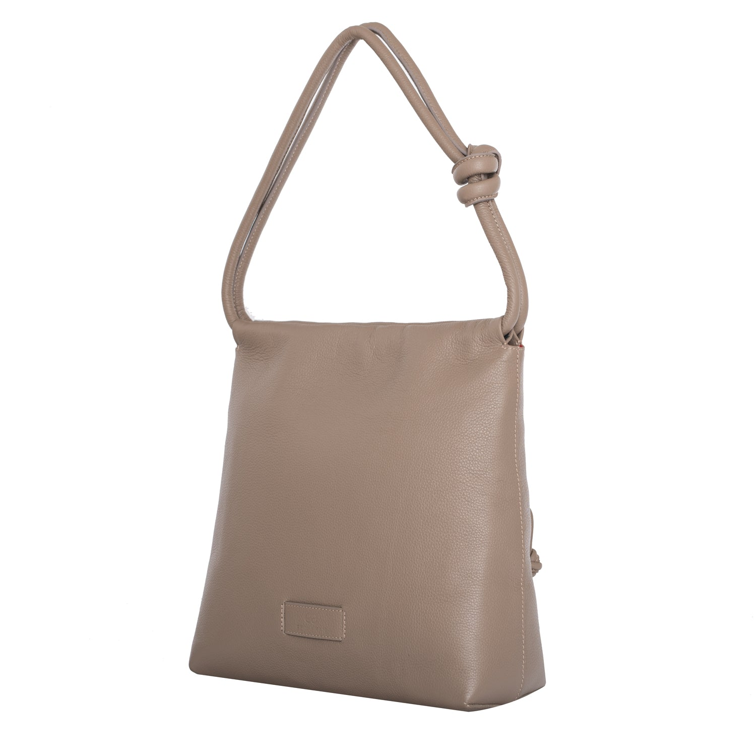 A convertible leather nude shoulder bag for women with a knot detail on the strap that could be used as a clutch bag with its roll down feature, side image.