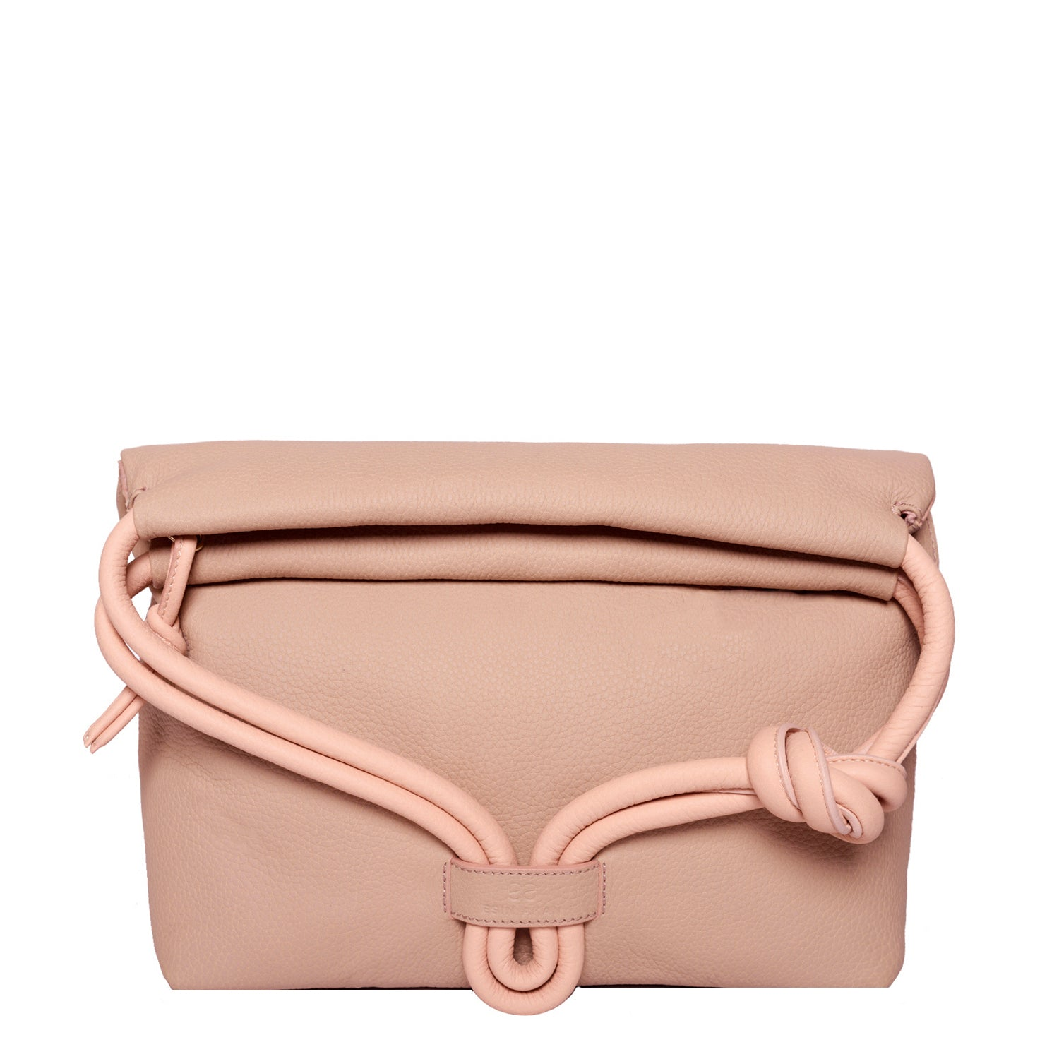 A convertible leather pink shoulder bag for women with a knot detail on the strap shown as a clutch bag, front image.